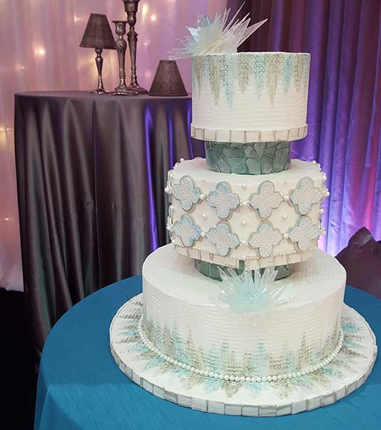 White Wedding Cake — Bloomington, MN — Denny's 5th Avenue Bakery